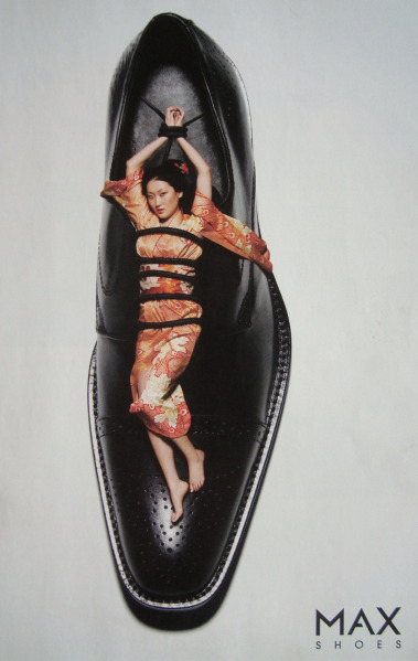 Okay, obvious: what in the hell does an Asian woman have to do with men's footwear? And how is sexualized violence supposed to make this shoe attractive?